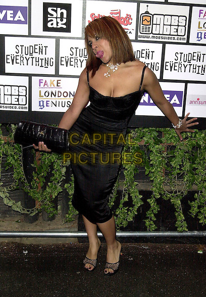 NARINDER KAUR.Naughty Boy launch party at Rouge nightclub.15 December 2003.big brother contestant, full length, full-length, little black dress, cleavage, funny face, tongue.www.capitalpictures.com.sales@capitalpictures.com.©Capital Pictures.