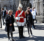 Horse Guard soldier with tourists, Horse Guards building, Whitehall, London, England
