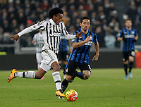 Calcio, semifinali di andata di Coppa Italia: Juventus vs Inter. Torino, Juventus Stadium, 27 gennaio 2016.<br /> Juventus&rsquo; Juan Cuadrad, left, is challenged by FC Inter&rsquo;s Yuto Nagatomo during the Italian Cup semifinal first leg football match between Juventus and FC Inter at Juventus stadium, 27 January 2016.<br /> UPDATE IMAGES PRESS/Isabella Bonotto