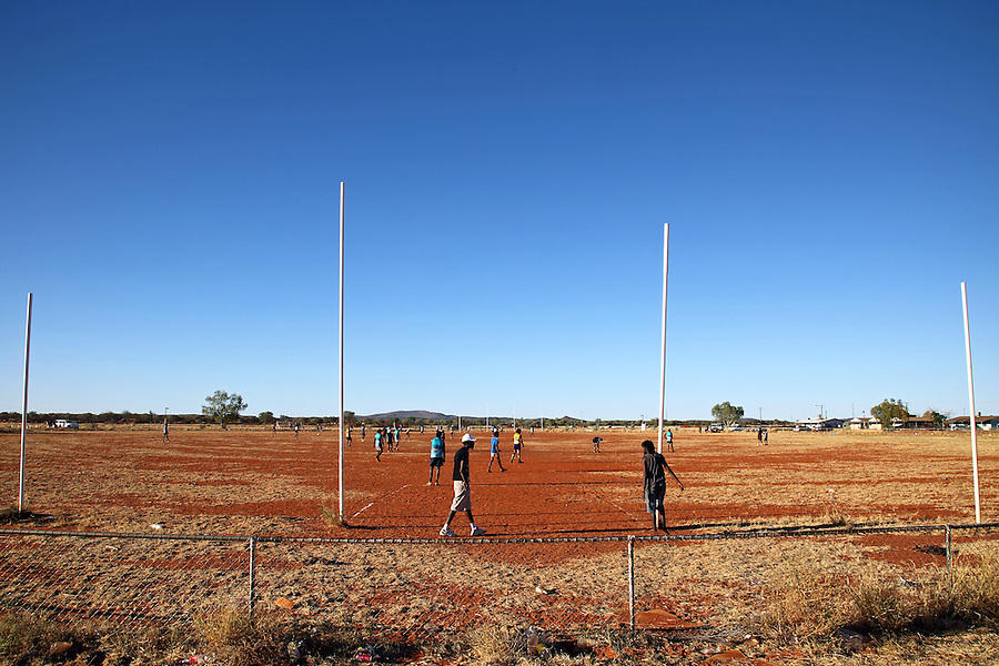 Yuendumu Community  Football Oval. Once a year communities from all over Central Australia gather to compete at the Yuendumu Sports Weekend. Australian Rules is the game of choice and is fiercely competitive. Football in Central Australia is closely watched  by scouts from the AFL National League and has produced many stars of the game.<br /> For those individuals, the last being Liam Jarrah from Yuendumu, to go from living in a small desert community and have to move  to a capital city and play in front of thousands must be an incredible experience. The few who make it become Idols, those that don't still can become local stars.