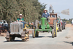 Annual fall Gas-Up at McFarland Ranch near Galt, Calif. of Branch 13, Early-Day Gas Engine and Tractor Association. (EDGE & TA)..Bev Davis with this c. 1931 Caterpillar Ten crawler tractor in the parade followed by a vintage John Deere tractor