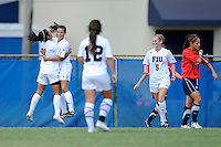 2 October 2011:  FIU's Kim Lopez (7) and Ashleigh Shim (9) hug in celebration of Shim's goal in the first half as the FIU Golden Panthers defeated the University of South Alabama Jaguars, 2-0, at University Park Stadium in Miami, Florida.