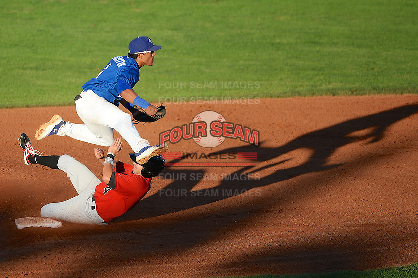 Jesmuel Valentin (6) of the Ogden Raptors starts the double play as Great Falls Voyagers second baseman Christian Stringer (4) slides in Pioneer League play at Lindquist Field on August 13, 2013 in Ogden Utah. (Stephen Smith/Four Seam Images)