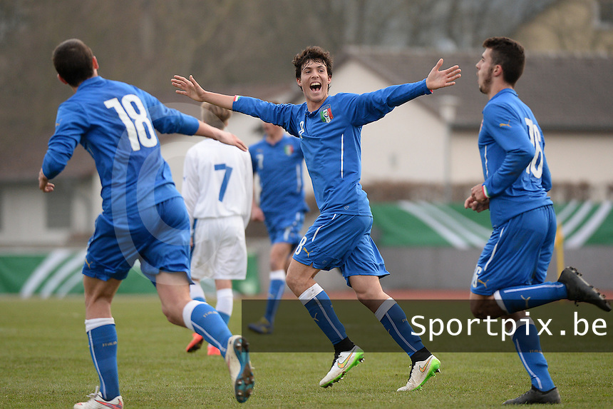 20150323 - MARBURG , GERMANY  : Italian Edoardo Degl'Innocenti (middle) pictured celebrating the second goal of teammate Patrick Cutrone (right) and the 2-0 lead during the soccer match between Under 17 teams of Slovakia and Italy , on the second matchday in group 8 of the UEFA Elite Round Under 17 at Georg-Gassmann , Marburg Germany . Monday 23 rd  March 2015 . PHOTO DAVID CATRY