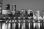 Bellevue Skyline with city lights and reflections in pond from downtown park at twilight