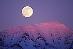 Full moon and alpenglow on the peaks of the Mission Mountains