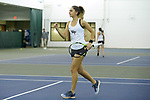 Eliza Omirou of the Wake Forest Demon Deacons pumps her fist after winning a point during the match against the Liberty Flames at the Wake Forest Indoor Tennis Center on March 11, 2017 in Winston-Salem, North Carolina. The Demon Deacons defeated the Flames 7-0.  (Brian Westerholt/Sports On Film)