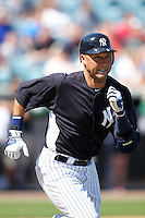 New York Yankees shortstop Derek Jeter #2 runs to first during a scrimmage against the USF Bulls at Steinbrenner Field on March 2, 2012 in Tampa, Florida.  New York defeated South Florida 11-0.  (Mike Janes/Four Seam Images)
