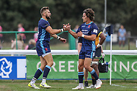 Charlie Ingall of London Scottish (left) celebrates after he scores a try during the Greene King IPA Championship match between London Scottish Football Club and Ealing Trailfinders at Richmond Athletic Ground, Richmond, United Kingdom on 8 September 2018. Photo by David Horn.