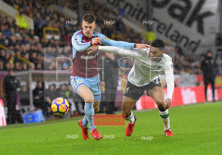 01/01/2018 Premier League Burnley v Liverpool<br /> <br /> Johann Berg Gudmundsson forces past Joeseph Gomez