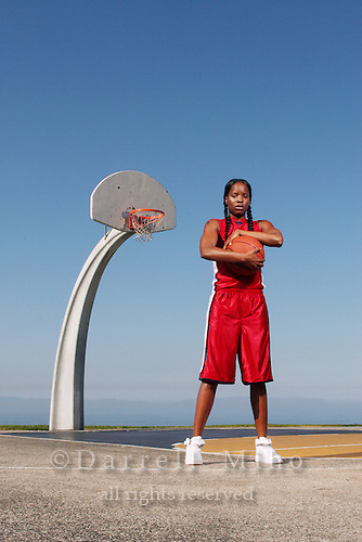 Model: Lakreshia Hart poses on a basketball court.<br />