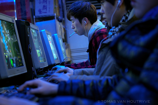 "Young men play computer video games in a ""PC bang"" in Seoul, South Korea on Jan. 26, 2012. ""PC bang"" means ""PC room"" or internet café in Korean. The internet cafés are extremely popular, especially with teenage and college-age males. Although most Koreans have computers at home or internet connected mobile devices, the PC bangs are popular for their social atmosphere. Friends can play connected LAN games together, like the popular StarCraft. Smoking, drinking and eating are also permitted in the PC bangs, meaning that people stay for long hours and the atmosphere resembles more a smokey billiards hall than an internet café in Western countries."