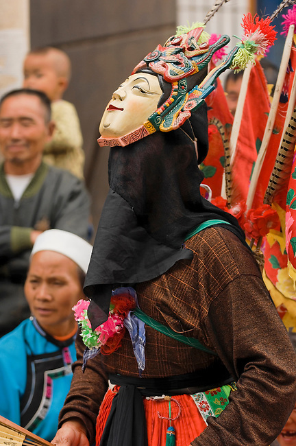 Traditional Masked, Dance Ground Opera.  Masks worn on forehead because it was originally staged in a natural amphitheater with the viewers above the performers.