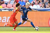 Sandy, Utah - Thursday June 07, 2018: Lou Jiahui, Megan Rapinoe during an international friendly match between the women's national teams of the United States (USA) and China PR (CHN) at Rio Tinto Stadium.