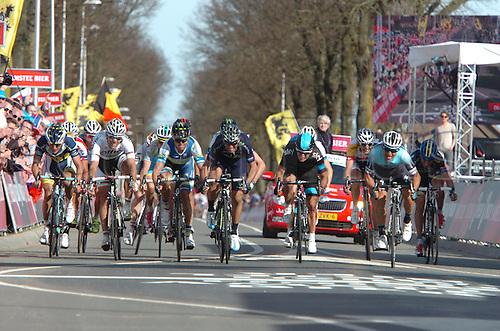 14.04.2013 Valkenburg, Holland. Gerrans Simon, Valverde Alejandro, Gilbert Philippe, Leukemans Bjorn, Henao Sergio, Kwiatkowski Michal,  cross the finish line.
