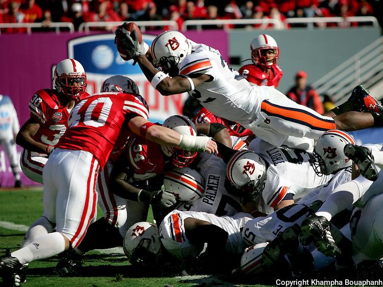 Auburn University's Carl Stewart dives in for a second quarter touchdown against Nebraska University in the Cotton Bowl Classic football game on Monday, January 1, 2007.  (Star-Telegram/Khampha Bouaphanh)