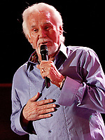 """20 March 2020 - Kenny Rogers, whose legendary music career spanned nearly six decades, has died at the age of 81. Rogers was inducted to the Country Music Hall of Fame in 2013."""" He had 24 No. 1 hits and through his career more than 50 million albums sold in the US alone. He was a six-time Country Music Awards winner and three-time Grammy Award winner. Some of his hits included """"Lady,"""" """"Lucille,"""" """"We've Got Tonight,"""" """"Islands In The Stream,"""" and """"Through the Years."""" His 1978 song """"The Gambler"""" inspired multiple TV movies, with Rogers as the main character. File Photo: July 14, 2012 - Atlanta, GA - Legendary country singer and actor Kenny Rogers made a stop along with Glen Campbell at the Chastain Park Amphitheater in Atlanta, GA., where the two friends performed their hits for an enthusiastic crowd of fans. Photo credit: Dan Harr/AdMedia"""
