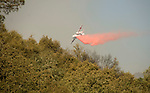 Calfire's Tanker 90, a military-converted ST-2 aircraft drops retardant on the Middle Bar Fire in Calaveras County.