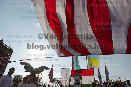 Flag is weaved during a political gathering of Hungarian far-right political party Jobbik to celebrate the fourth anniversary of their paramilitary group Hungarian Guard (or Magyar Garda in Hungarian) in Budapest, Hungary on August 28, 2011. ATTILA VOLGYI