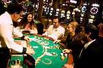 Blackjack table in Las Vegas, Nevada, Caesars Palace and Casino, gaming, gambling, chips, blackjack, betting croupier, blackjack players, model released, blackjack table, cards, NV, Las Vegas, Photo nv235-18331..Copyright: Lee Foster, www.fostertravel.com, 510-549-2202,lee@fostertravel.com