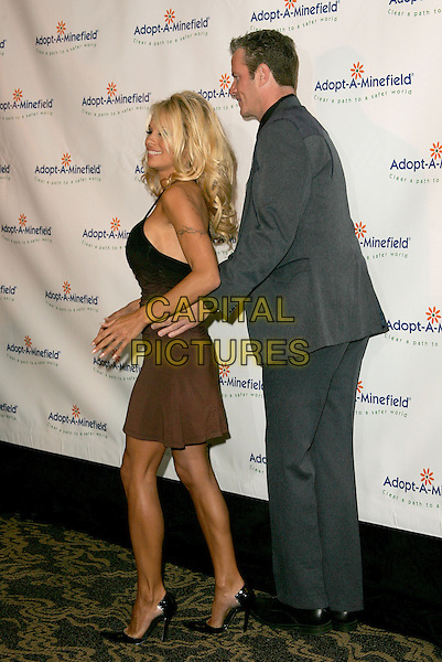 PAMELA ANDERSON & VP of Peta, DAN MATHEWS -MATTHEWS.The 4th Annual Benefit Gala for Adopt-A-Minefield held at The Century Plaza Hotel in Century City, California.October 15th, 2004.full length, brown, black dress, tattoo, arms around waist, funny, gesture.www.capitalpictures.com.sales@capitalpictures.com.©Debbie Van Story/Capital Pictures
