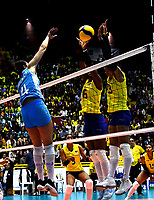 BOGOTÁ-COLOMBIA, 09-01-2020: Valerín Carabalí y Amanda Coneo de Colombia, intentan un bloqueo al ataque de balón a Daniela Bulaich de Argentina, durante partido entre Argentina y Colombia en el Preolímpico Suramericano de Voleibol, clasificatorio a los Juegos Olímpicos Tokio 2020, jugado en el Coliseo del Salitre en la ciudad de Bogotá del 7 al 9 de enero de 2020. / Valerin Carabali y Amanda Coneo from Colombia, trie to block the attack the ball to Daniela Bulaich from Argentina, during a match between Argentina and Colombia, in the South American Volleyball Pre-Olympic Championship, qualifier for the Tokyo 2020 Olympic Games, played in the Colosseum El Salitre in Bogota city, from January 7 to 9, 2020. Photo: VizzorImage / Luis Ramírez / Staff.