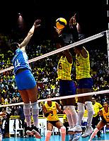 BOGOTÁ-COLOMBIA, 09-01-2020: Valerín Carabalí y Amanda Coneo de Colombia, intentan un bloqueo al ataque de balón a Daniela Bulaich de Argentina, durante partido entre Argentina y Colombia en el Preolímpico Suramericano de Voleibol, clasificatorio a los Juegos Olímpicos Tokio 2020, jugado en el Coliseo del Salitre en la ciudad de Bogotá del 7 al 9 de enero de 2020. / Valerin Carabali y Amanda Coneo from Colombia, trie to block the attack the ball to Daniela Bulaich from Argentina, during a match between Argentina and Colombia, in the South American Volleyball Pre-Olympic Championship, qualifier for the Tokyo 2020 Olympic Games, played in the Colosseum El Salitre in Bogota city, from January 7 to 9, 2020. Photo: VizzorImage / Luis Ramírez / Staff.