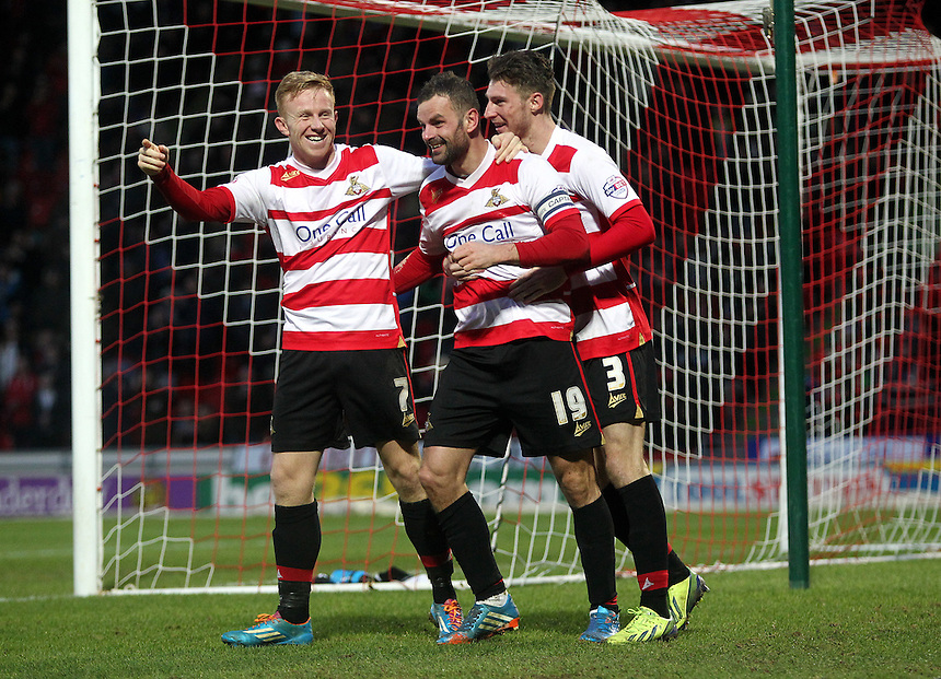 Doncaster Rovers' Richard Wellens (centre) celebrates scoring his sides second goal with team-mates Mark Duffy(left) and James Husband<br /> <br /> Photo by Rich Linley/CameraSport<br /> <br /> Football - The Football League Sky Bet Championship - Doncaster Rovers v Wigan Athletic - Saturday 18th January 2014 - Keepmoat Stadium - Doncaster<br /> <br /> &copy; CameraSport - 43 Linden Ave. Countesthorpe. Leicester. England. LE8 5PG - Tel: +44 (0) 116 277 4147 - admin@camerasport.com - www.camerasport.com