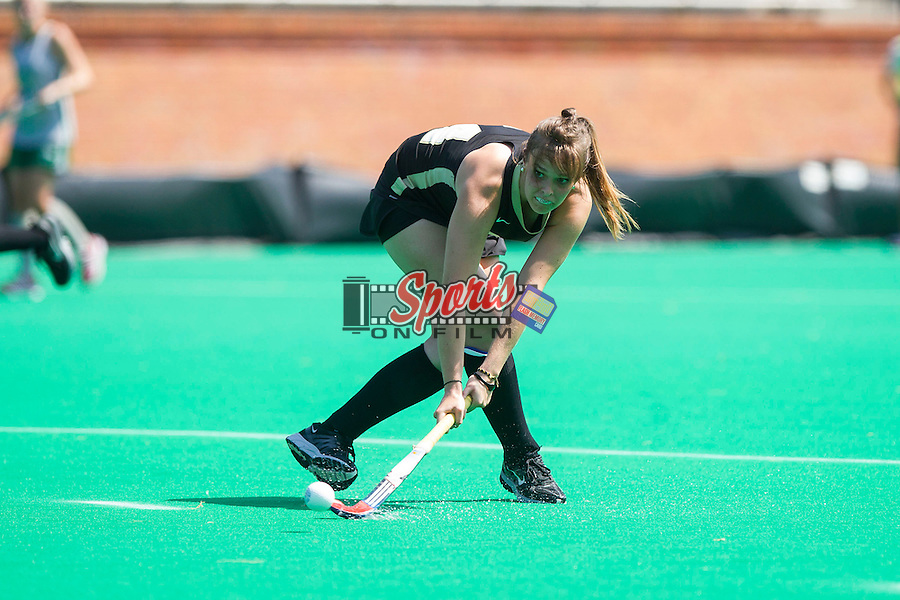 Holly Brown (24) of the Wake Forest Demon Deacons takes a backhand shot on goal during second half action against the William & Mary Tribe at Kentner Stadium on September 15, 2013 in Winston-Salem, North Carolina.  The Demon Deacons defeated the Tribe 4-0.  (Brian Westerholt/Sports On Film)