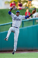 Hector Gomez (5) of the Tulsa Drillers comes down after a leaping throw to first during a game against the Springfield Cardinals at Hammons Field on July 18, 2011 in Springfield, Missouri. Tulsa defeated Springfield 13-8. (David Welker / Four Seam Images)