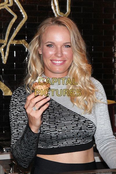 NEW YORK, NY - AUGUST 24: GODIVA Chocolatier's ambassador and tennis star, Caroline Wozniacki makes an appearance at the MetLife GODIVA Boutique and promotes the brand's Soft Serve ice cream  on August 24, 2015 in New York City. <br /> CAP/MPI99<br /> &copy;MPI99/Capital Pictures