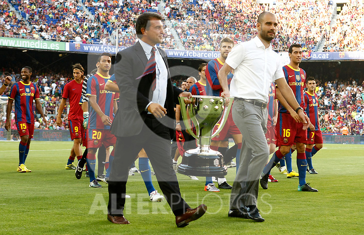 FC Barcelona's players, ex president Joan Laporta and the coach Pep Guardiola with the Trophy of Champions in La Liga 2009-2010 during Joan Gamper Trophy. August 25,2010. (ALTERPHOTOS/Acero)