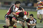 Male Sa'u & Niva Ta'auso tackle David Hill during the Air NZ Cup week 5 game between Waikato & Counties Manukau played at Rugby Park, Hamilton on 26th of August 2006.