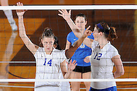 22 November 2008:  New Orleans middle blocker Edina Dobi (14) and other teammates signal each other during the WKU 3-0 victory over New Orleans in the championship game of the Sun Belt Conference tournament at U.S. Century Bank Arena in Miami, Florida.
