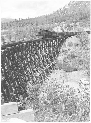 Leased D&amp;RGW #464 hauling gondolas across trestle 160-A.<br /> RGS  Franklin Junction, CO  Taken by Richardson, Robert W. - 8/7/1952