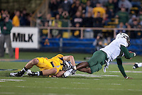 Chris Conte holds on to Darron Thomas's ankles to make the tackle. The Oregon Ducks defeated the California Golden Bears 15-13 at Memorial Stadium in Berkeley, California on November 13th, 2010