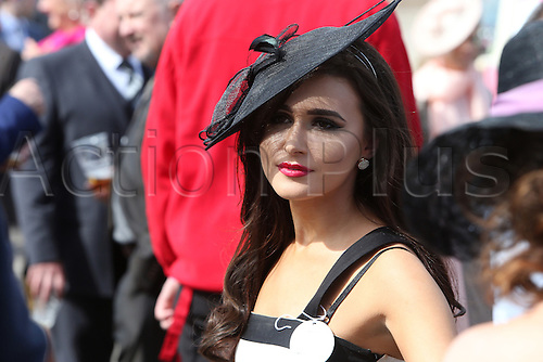 08.04.2016. Aintree, Liverpool, England. Crabbies Grand National Festival Day 2. An elegant racing fan ahead of the opening race of the day.