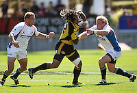 Cheetahs replacements Meyer Bosman (left) and Adriaan Strauss try to tackle Ma'a Nonu..Super 14 rugby union match, Hurricanes v Cheetahs at Yarrows Stadium, New Plymouth, New Zealand. Saturday 7 March 2009. Photo: Dave Lintott / lintottphoto.co.nz