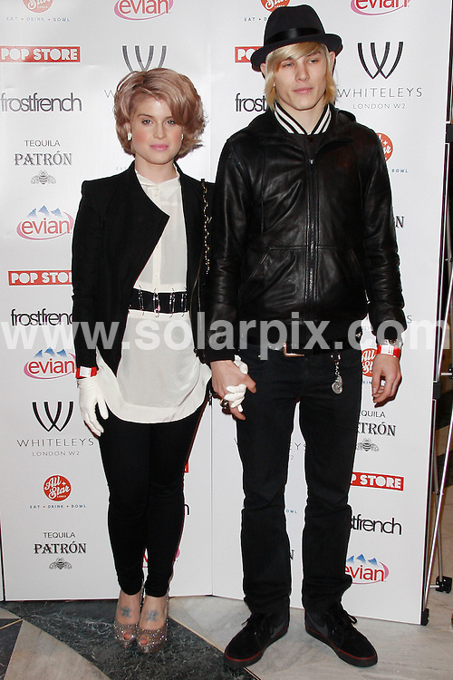 **ALL ROUND PICTURES FROM SOLARPIX.COM**.**WORLDWIDE SYNDICATION RIGHTS**.Whiteleys FrostFrench Pop-Up Store launch party at Whiteleys Shopping Centre, Queensway, Bayswater, London, UK. 25 March 2010. ..This pic: Kelly Osbourne and boyfriend Luke Worrell..JOB REF: 10983 LNJ     DATE: 25_03_2010.**MUST CREDIT SOLARPIX.COM OR DOUBLE FEE WILL BE CHARGED**.**MUST NOTIFY SOLARPIX OF ONLINE USAGE**.**CALL US ON: +34 952 811 768 or LOW RATE FROM UK 0844 617 7637**