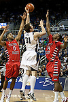 January 21, 2012:   Nevada Wolf Pack forward Olek Czyz shoots over Fresno State Bulldogs #0 Jerry Brown and #24 Kevin Foster in the first half during their NCAA game played at Lawlor Events Center in Reno, NV.