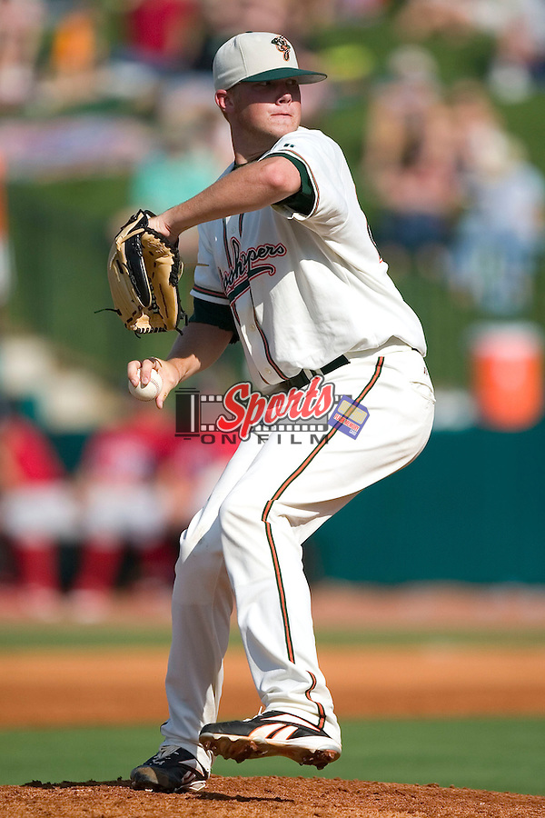 Greensboro starting pitcher Ryan Tucker winds up to deliver the ball to the plate versus Lakewood at First Horizon Park in Greensboro, NC, Sunday, July 16, 2006.  The Grasshoppers defeated the BlueClaws 7-4.