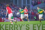 Paul Geaney of Kerry launches an attack as Cork's captain Aidan Walsh fails to stop him in the Munster U21 Football Championship Final held on Wednesday night in Pairc Ui Rinn Cork.