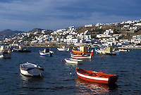 Mykonos, Cyclades, Greek Islands, Greece, Europe, Fishing boats buoyed in Mykonos Harbor on the Aegean Sea.