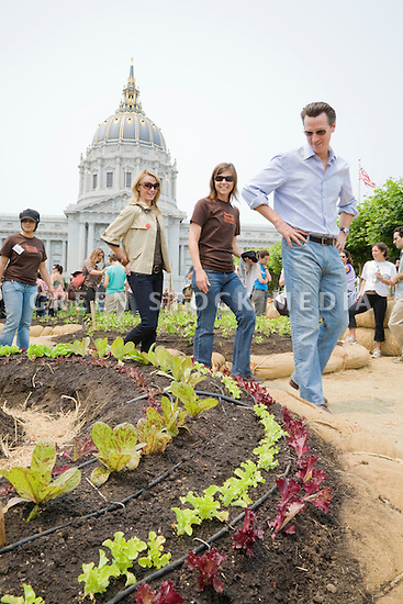 "San Francisco Mayor Gavin Newsom (R) and Jennifer Siebel (2nd from L), fiancee, take a tour with Slow Food Nation's Naomi Starkman (middle) at Community Planting Day (July 12, 2008) of the Slow Food Nation Victory Garden at San Francisco's Civic Center. The garden project ""demonstrates the potential of a truly local agriculture practice that unites and promotes Bay Area urban gardening organizations, while producing high quality food for those in need.""* The garden is planted on the same site as the post-World War II garden sixty years ago. The food will be grown over a period of two months, harvested, and donated to people in need..*slowfoodnation.org"