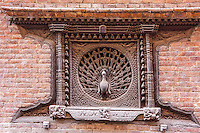 Bhaktapur, Nepal.  The Peacock Window, 15th. Century, in the Pujari Math.  The building was heavily damaged in the April 2015 earthquake, but the window survived.