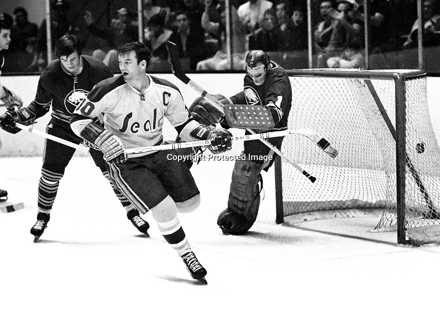 Seals Ted Hampson scores against the Sabres goalie .Roger Crozier..(1971 photo/Ron Riesterer)