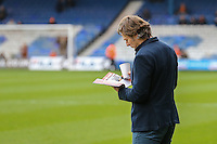 Gareth Ainsworth (Manager) of Wycombe Wanderers reads the matchday programme ahead of the Sky Bet League 2 match between Luton Town and Wycombe Wanderers at Kenilworth Road, Luton, England on 26 December 2015. Photo by David Horn.