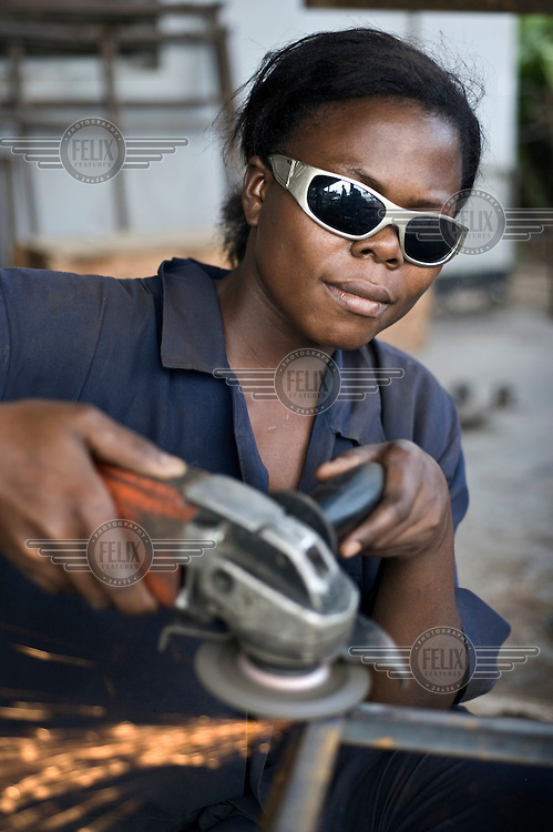 20 year old Amisa works as a welder after receiving training at St. Anthony Vocational Training Centre, a Catholic educational centre run by nuns. The school is supported by NGO Terre Des Hommes..