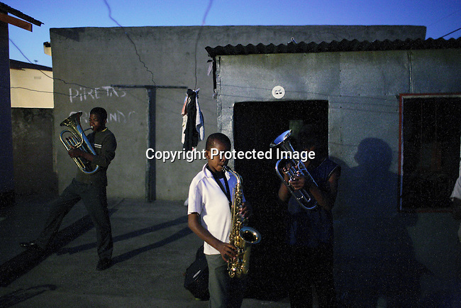 SOWETO, SOUTH AFRICA - OCTOBER 10: Youth members of a Brass band rehearse in the back yard of a home in Soweto on October 10, 2007. (Photo by: Per-Anders Pettersson)