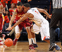 Dec. 30, 2010; Charlottesville, VA, USA; Virginia Cavaliers guard Jontel Evans (1) fouls Iowa State Cyclones guard Diante Garrett (10) during the game at the John Paul Jones Arena. Iowa State Cyclones won 60-47. Mandatory Credit: Andrew Shurtleff